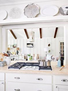 A cramped kitchen feels much more open with a pass through that connects the kitchen to an adjacent room without entirely eliminating a wall that's necessary structurally or for storage.