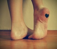 Heart under the foot! Live this tattoo
