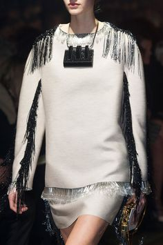 Minimal structured silhouette with bold beaded fringe along the seams & hem; fashion details // Lanvin