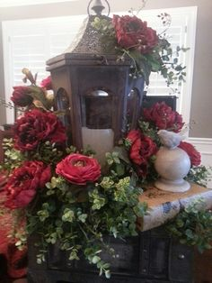 Check out the roses.  Who would of thought to use them for Christmas?