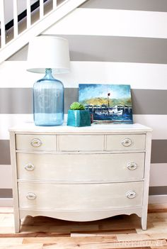 Vintage oak dresser painted white - love the stripes & the lamp (there's a tutorial here for the lamp!)