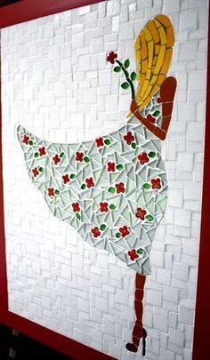 A imagem de uma jovem com um botão de flor nas mãos, ao sabor do vento, remete a algo singelo, simples, delicado que pode servir de decoração para vários ambientes. O quadro em mosaico com elaborado com pastilhas de vidro, azulejo e flores em cerâmica. Essas flores poderão ser diferentes, de aco...
