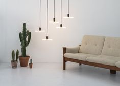 Curli is a swirl of light that takes its formal inspiration from the calligraphic flourish of the curlicue to create a continuous asymmetric coil that twists up and around the bulb holder Glass Bar, Light Fittings, Wall Mount, Light Bulb, Lamps, Table Lamp, Ceiling Lights, Pure Products, Contemporary