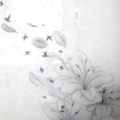 Flower blowing into birds tattoo