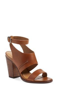 Absolutely adoring these open-toe sandals. With bold leather straps and a chunky stacked heel, these shoes will elevate any look.