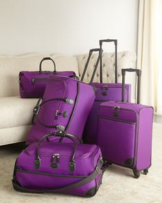 "Bric's Purple ""Pronto"" Luggage. Elegant, sophisticated, lightweight travel bags in durable, easy-to-clean, abrasion-resistant, purple denier nylon over a polyfoam frame have poly-coated nylon linings and PVC trim. Ultra-lightweight four-wheel spinner trolleys and rolling duffels have retractable handles and pockets for easy organization."