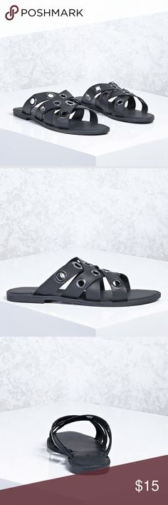 "🆕 Faux leather slides ! A pair of faux leather slides featuring a crossover strapped design with oversized grommet accents and a slip-on style.  Size + Fit  - Heel: 0.3""  - Shaft height: 3"" Forever 21 Shoes Sandals"