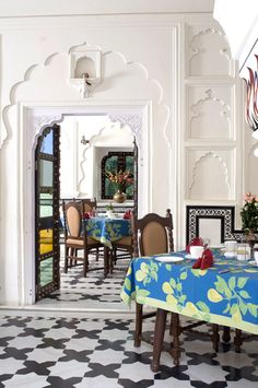 Sabahaveli Hotel. White walls with engravings  and coloured doors how beautiful
