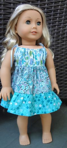 Blue mixed print drawstring dress by GumbieCatDollClothes on Etsy. Made with the LJC Drawstring Dress pattern. Get it here http://www.pixiefaire.com/products/drawstring-dress-18-doll-clothes. #pixiefaire #libertyjane #drawstringdress