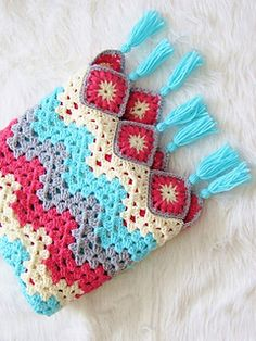 Choose the right colors and turn this traditional crochet pattern into a contemporary afghan to adorn your home. The granny ripple and granny squares have been combined to make this easy to work afghan that brings spring right into your house.