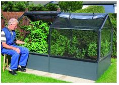 I Like this planter/greenhouse which is available at Costco.  However, I think I could probably make something pretty similar with wood/straw bales/or? as a base and pvc pipe/heavy mil plastic as a top (and it would be much cheaper).  Additional note:  I just got a grommet kit from Walmart Sporting Goods to attach grommets to the plastic.  I can then attach it to the frame with wire or twine.