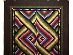 Bargello Links Quilt. Spectacular design with outstanding fabrics selected by Hannah. Note the care taken with the challenging patchwork piecing. Made by local Amish woman.