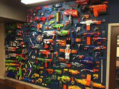 We made this Nerf gun cabinet with 2 IKEA Besta shelf frames. The gun