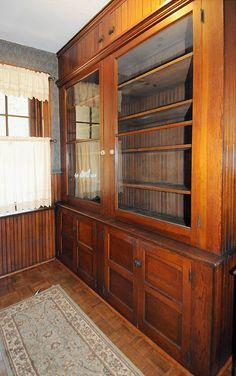 A butler's pantry, from 1905 home, includes original wood and glass cabinetry.