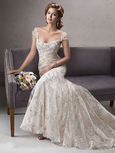 Sottero and Midgley - ettiene, Exquisite beaded embroidered lace on tulle drapes over delustered satin in this fit and flare gown featuring dazzling Swarovski crystals on the neckline and shoulder straps.  Complete with scoop neckline and finished with crystal button and zipper over inner corset closure.