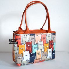 Kabelka+Cats+Materiál:+syntetická+kůže,+Oxford+Uvnitř:+kvalita+prošívaná+podšívka,vnitřní+kapsa+Rukojeť:+65+cm+Velikost:+29+x+36+cm,+tloušťka+dna+a+po+stranách+-+10cm+kosmetička+se+stejným+motivem