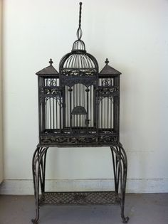 Beautiful birdcage. I would fill it with flowers and little faux birds.