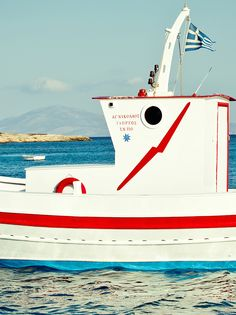A colorfully painted fishing boat in the Greek Islands