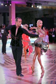 Riccardo and Yulia. Love her dress.