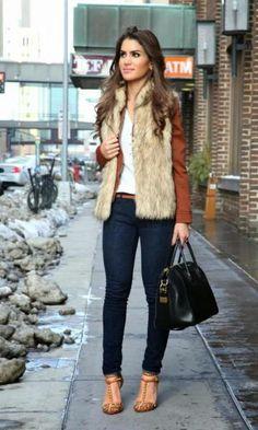 Brown faux fur vest over a brown blazer, white shirt, skinny jeans, leopard shoes, black handbag, brown belt