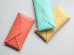 Leather envelopes in watermelon, spearmint & custard.