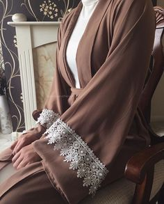 The reason we love this abaya is because of how elegant it is! The open abaya features a thick crochet trim with hand glued pearls. Arab Fashion, Islamic Fashion, Muslim Fashion, Modest Fashion, Fashion Outfits, Hijab Dress, Hijab Outfit, Hijab Style, Hijab Chic