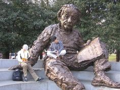 Albert Einstein Memorial is a monumental bronze statue depicting Albert Einstein seated with manuscript papers in hand. It is located in central Washington, D.C., in a grove of trees at the southwest corner of the grounds of the National Academy of Sciences.