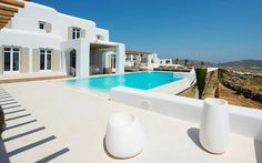 The spacious outdoor surrounding of Villa Zircon is occupied by its own private infinity edge swimming pool. The pool deck, also features sun beds for sunbathing with sea views and a large shaded lounge area with a built-in sofa. Mykonos Villas, Built In Sofa, Amazing Swimming Pools, Mykonos Island, Villa With Private Pool, Dream Pools, Summer Dream, Vacation Villas, Luxury Villa