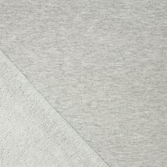 Heather Gray Solid Cotton French Terry Knit Fabric - A Girl Charlee designer overstock score!  A looser weave and lighter weight heather gray solid cotton modal french terry blend knit.  French terry has a smooth jersey top side and a , diagonal loop terry pile on bottom side.  Fabric has a smooth, tight hand, nice loose drape, and a small stretch.  ::  $7.50