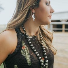Rusty silver color Beads have a western Navajo pearl look Sits at a great length Great for layering with other necklaces Shown with The Alamo Thank
