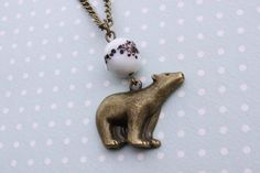 Lovely polar bear necklace with ceramic bead - Cabin Pressure necklace - Bear necklace on Etsy, $23.49