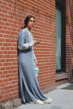 Dress down a gown with a graphic long-sleeve tee. #refinery29 http://www.refinery29.com/2016/09/120553/nyfw-spring-2017-best-street-style-outfits#slide-50