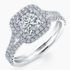 Cushion cut diamond set in 18k white gold split shank with double halo pave ring. (Available from .75 to 3 carats and with Forevermark diamonds)