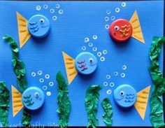 Bottle Cap Fish Use old bottle caps or milk caps to make an adorable ocean scene. Its a fun way to create using materials that might otherwise be thrown away. The post Bottle Cap Fish was featured on Fun Family Crafts. Kids Crafts, Animal Crafts For Kids, Family Crafts, Summer Crafts, Projects For Kids, Diy For Kids, Craft Projects, Arts And Crafts, Button Crafts For Kids
