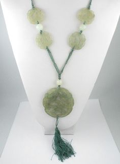 """Made of 5 pieces of carved green jade with openings, and 3 round jade beads, set on knotted green silk thread. Depicting chinese carved animals. Pendant part with bead and dangles: 7 1/4"""" (18.4 cm). 