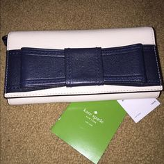 Kate Spade Villabella Wristlet Great condition! French navy Villabella Avenue with Mara Bow wristlet wallet Perfect to store your cell phone in the middle and still have lots of room for credit cards, coins and currency Genuine leather Features: 14 Credit Card/Photo Slots, 3 Larger Slots, 1 Slot on Backside of Wallet, and Center Zippered Change Section Interior features Kate Spade Stamp and Tag, and the Gold tone Kate Spade Emblem on Back of Wallet Convertible wristlet can slide into a…