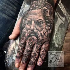 Zeus hand tattoo.