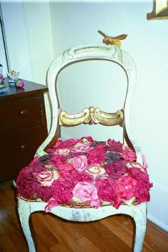 Chair I created with french wire ribbon roses.