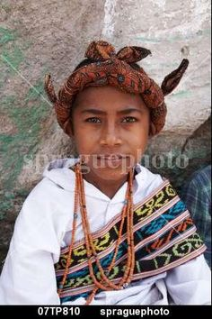 Boy wearing traditional dress including ikat weaves and beads,  Oecussi-Ambeno, East Timor stock image