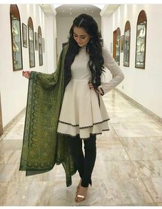 this girl just made her own indo-western version of a very appropriate outfit. layering a short dress with tights and pairing with a contrasting shawl Pakistani Fashion Casual, Pakistani Dresses Casual, Pakistani Dress Design, Indian Dresses, Indian Outfits, Indian Fashion, Punjabi Fashion, Frock Fashion, Fashion Dresses