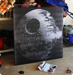 How cool is this death star art?  Particle board, engineer print from Staples and Christmas lights--perfection!