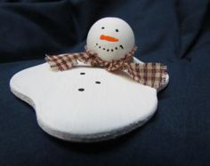 Wooden Snowman Ornament that Appears to be Melting Away