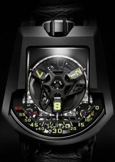 URWERK presenta su nueva creación UR-203 Edition Spéciale de 20 piezas que retoma las agujas telescópicas, los transportadores y el platino negro. Fiel a su concepto über- futurista, el equipo de URWERK vuelve con otra indicación robótica de las horas.