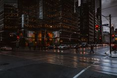 Toronto city street on a dark rainy day as evening sets in.