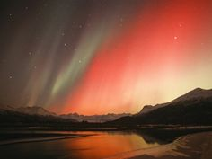 """All was normal at the top of descent until we both spotted what looked like an undulating patch of orange mist ahead and slightly below us. There was a sort of velvety sheen appearance to it. My captain and I looked at each other with the most unflattering miens, I'm sure, and exclaimed simultaneously: """"Northern lights…!!"""""""