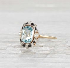 18k gold and platinum Edwardian ring, centered with a 1.40 carat aquamarine and accented with onyx, natural pearls and six single cut diamonds. Circa 1905 ~ we ❤ this! moncheribridals.com