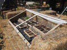 Great way to make an inexpensive giant cold frame - that won't cook your plants in the sun.