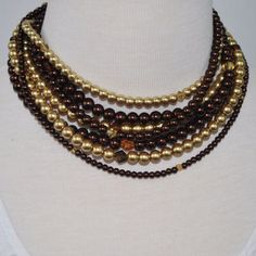 Brown and gold multi strand two toned glass pearls necklace