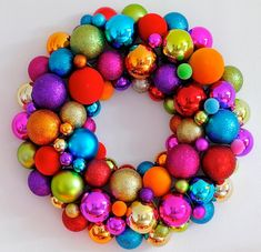 Christmas ornament wreaths are the perfect way to use those old, chipped  ornaments and turn them into something new and beautiful!    ...