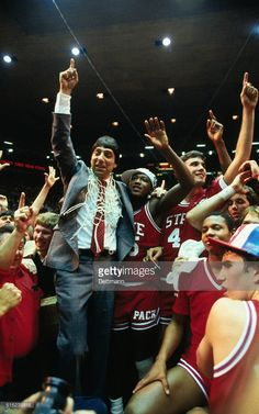 North Carolina State's coach Jim Valvano gives the winning sign as he stand with his winning team at the NCAA Final Four championship game. North Carolina defeated Houston in the championship game. Nc State Basketball, Basketball History, College Basketball, Jim Valvano, North Carolina Colleges, Ncaa Final Four, Nc State University, College Hoops, Basketball Photography